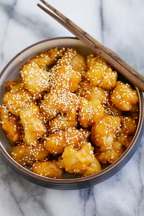 Delicious honey sesame chicken fried and coated in a sticky sweet and savory honey sesame sauce.