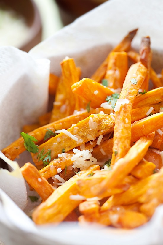 Easy and quick crispy and cheesy sweet potatoes and topped with Parmesan cheese in a basket.