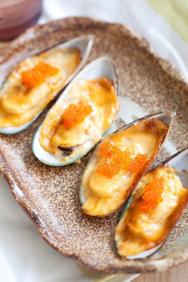 Baked mussels dynamite with cheese, mayo, mussels ready to serve.