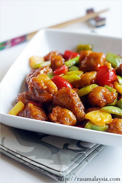 Sweet and sour pork easy delicious recipes colorful sweet and sour pork with pineapple and green and red peppers in a serving dish forumfinder Image collections