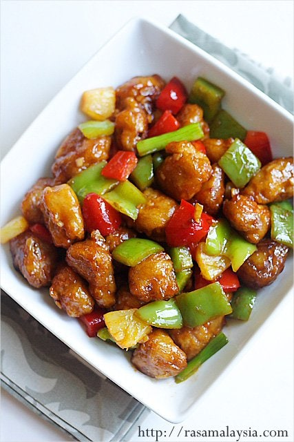 Sweet and sour pork easy delicious recipes glistening sweet and sour pork with green peppers and pineapple in a bowl made with homemade forumfinder Image collections
