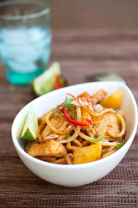 Easy veggie fried noodles recipe with ketchup, soy sauce, and lime in a bowl.