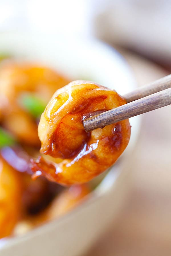 Kung Pao Shrimp picked with a pair of chopsticks.