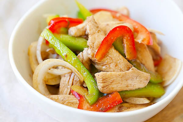 Yummy Asian stir-fry chicken with bell peppers serve in a bowl.