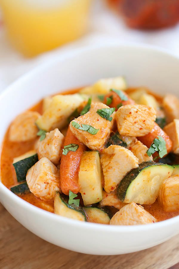 Zucchini and chicken Thai red curry in a bowl.