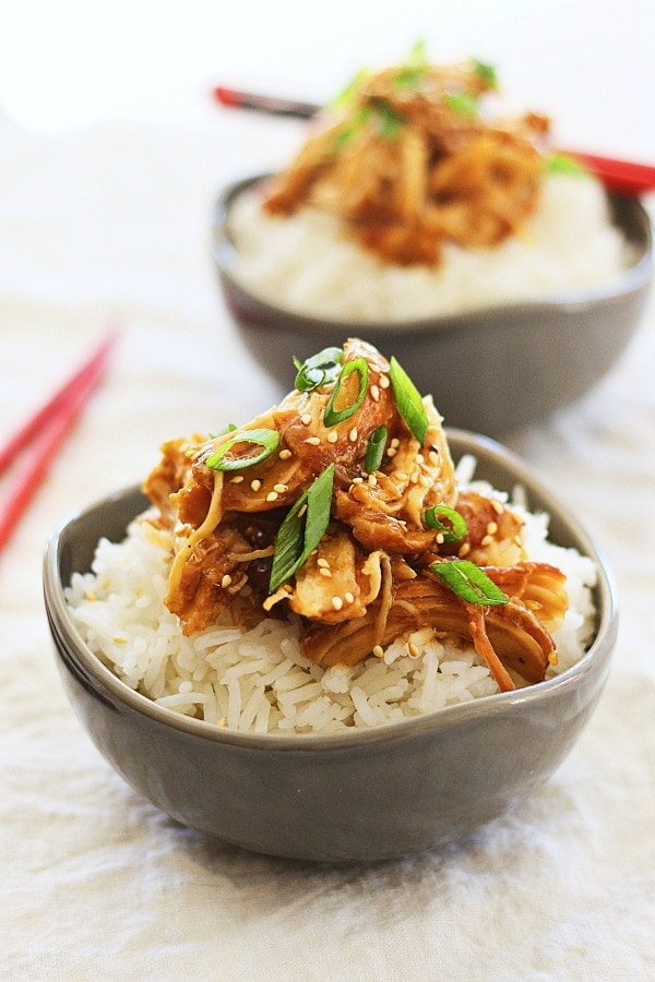 Slow cooked chicken with sweet, savory, and delicious honey teriyaki sauce on top of rice.