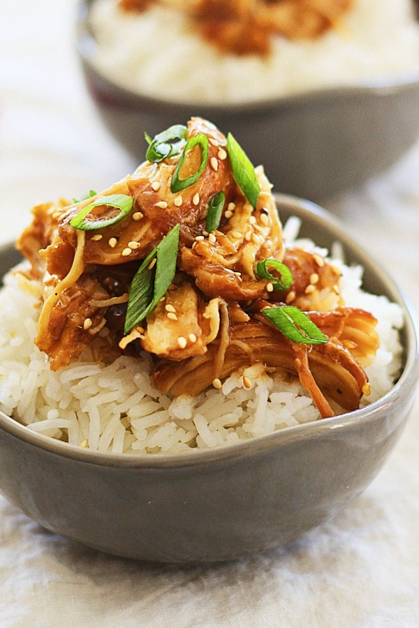 Slow Cooker Honey Teriyaki Chicken on top of rice in a bowl.