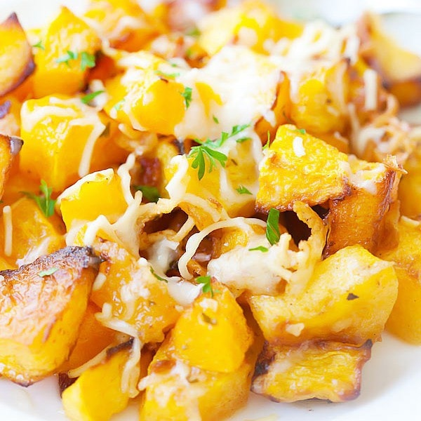 roasted butternut squash cubes with garlic and Parmesan cheese on top
