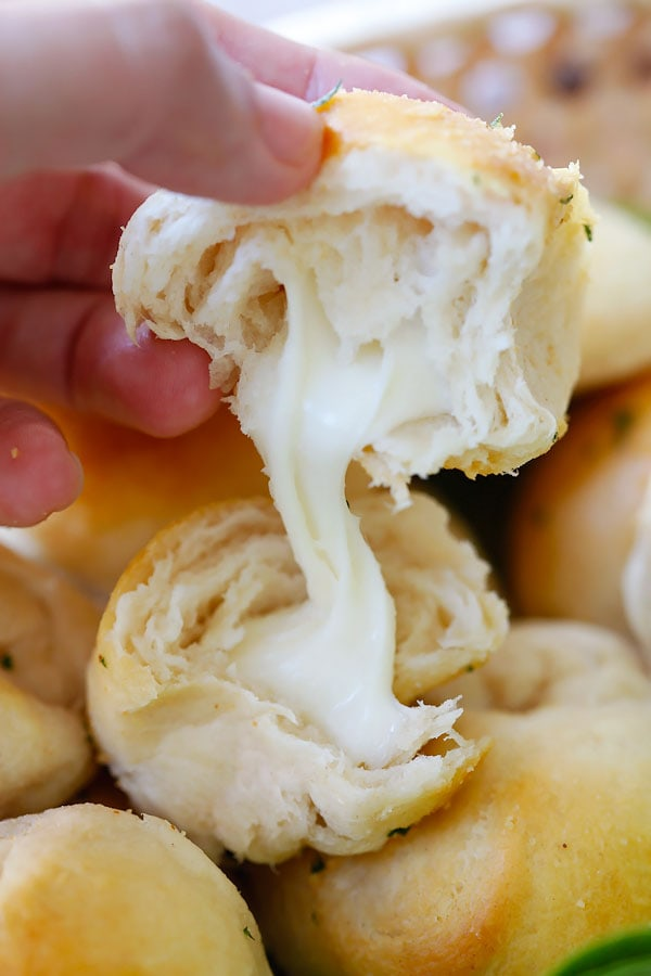 Easy and quick garlic herb cheese bombs in half with string Mozzarella cheese.