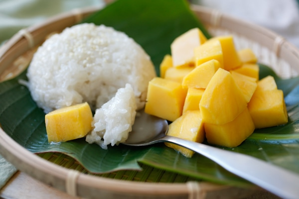 Mango sticky rice – a popular sweet sticky rice with coconut milk and fresh mangoes. Make your favorite Southeast Asian dessert at home   rasamalaysia.com