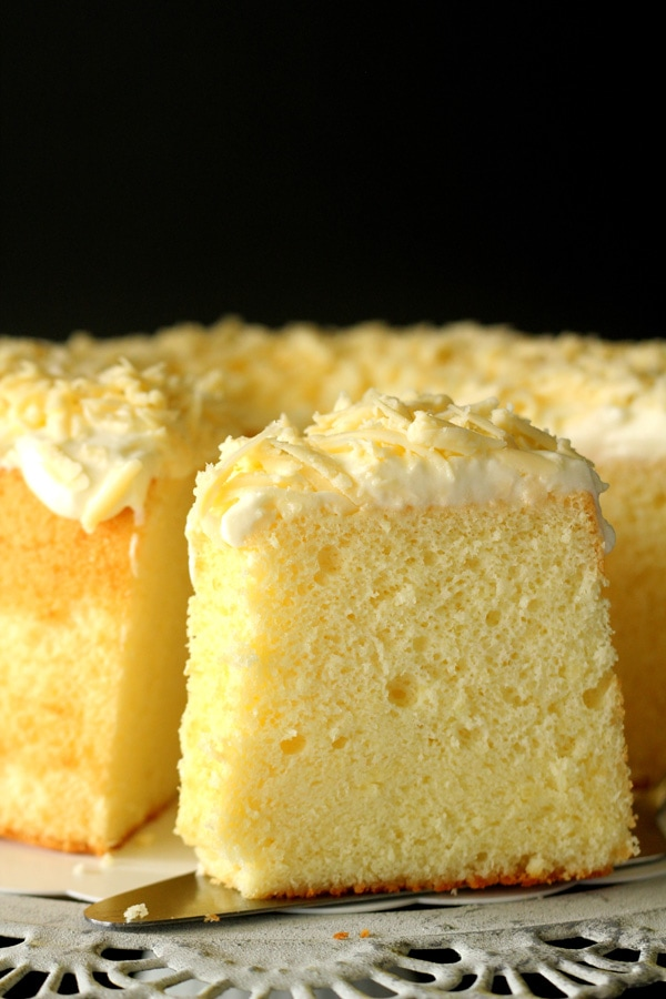 A sliced Parmesan chiffon cake made with Parmesan cheese, and topped with shredded Parmesan.