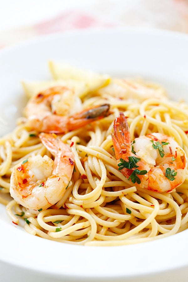 Spaghetti Aglio e Olio with Shrimp, garlic, olive oil, shrimp and red pepper flakes in a plate.