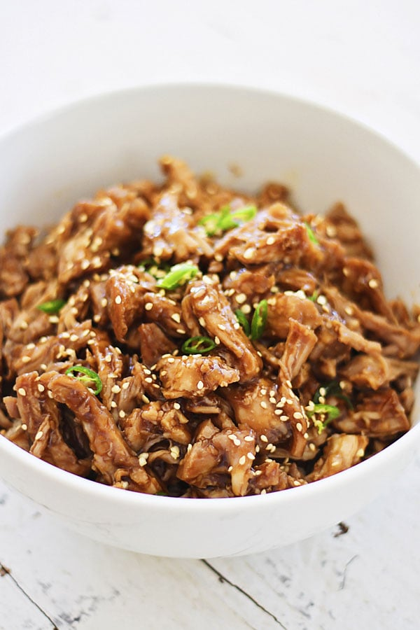 Asian style slow-cooked Crock Pot Honey Sesame Pulled Pork with honey sesame sauce.