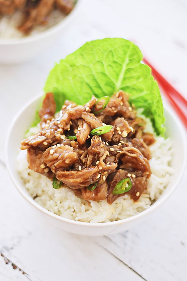 Easy Crock Pot Honey Sesame Pulled Pork on top of rice.