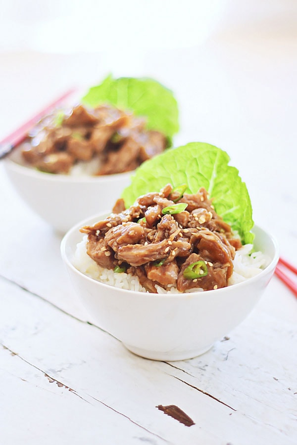Easy and healthy Crock Pot recipe for Honey Sesame Pulled Pork in a bowl.