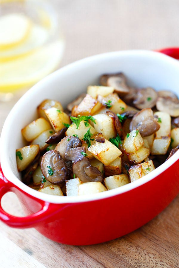All in one pan sauteed potatoes with mushroom in a serving dish.