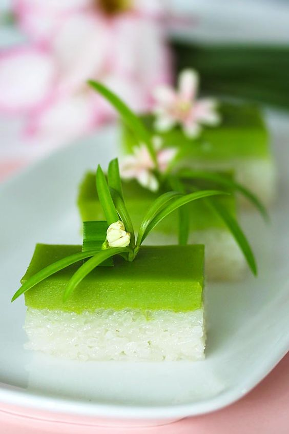 Seri Muka dessert, a Malaysian kuih (sweet cake) made of glutinous rice, coconut milk, sugar and pandan leaves, served in a dessert plate.
