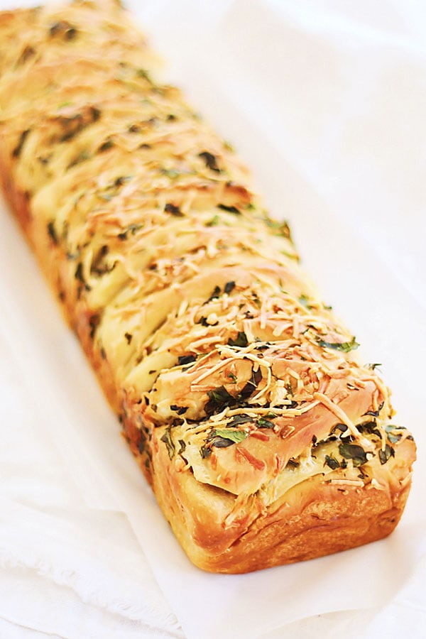 Easy and quick homemade loaf of garlic herb butter and cheese pull apart bread.