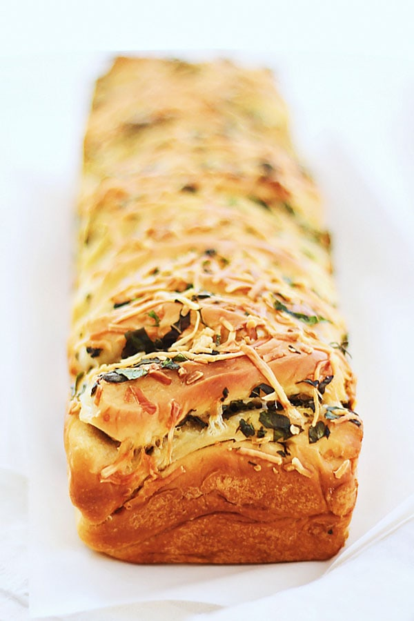 A loaf of delicious Garlic Herb and Cheese Pull Apart Bread. ready to serve