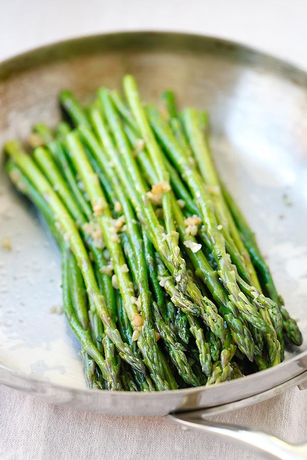 Garlic Butter Sauteed Asparagus in a silver serving ware.
