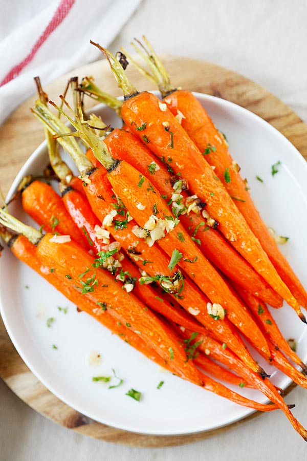 Top down view of honey Butter Roasted Carrots in a plate.
