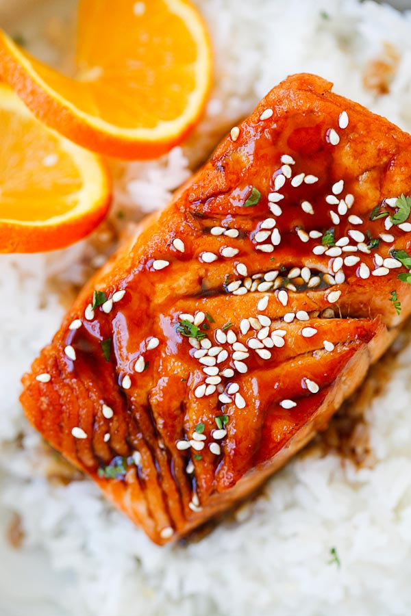 Close up Salmon with Orange Teriyaki Glaze garnished with sesame seeds.
