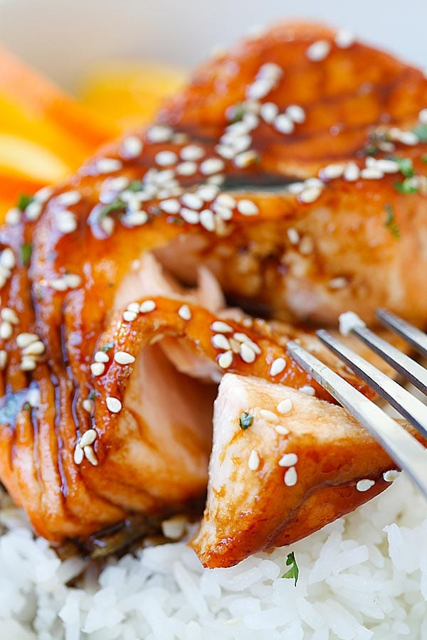 Salmon with Orange Teriyaki Glaze cut open with a fork.