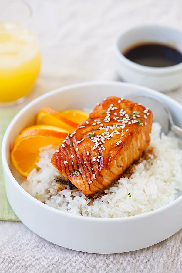 Easy Salmon with Orange Teriyaki Glaze sauce on top of rice.