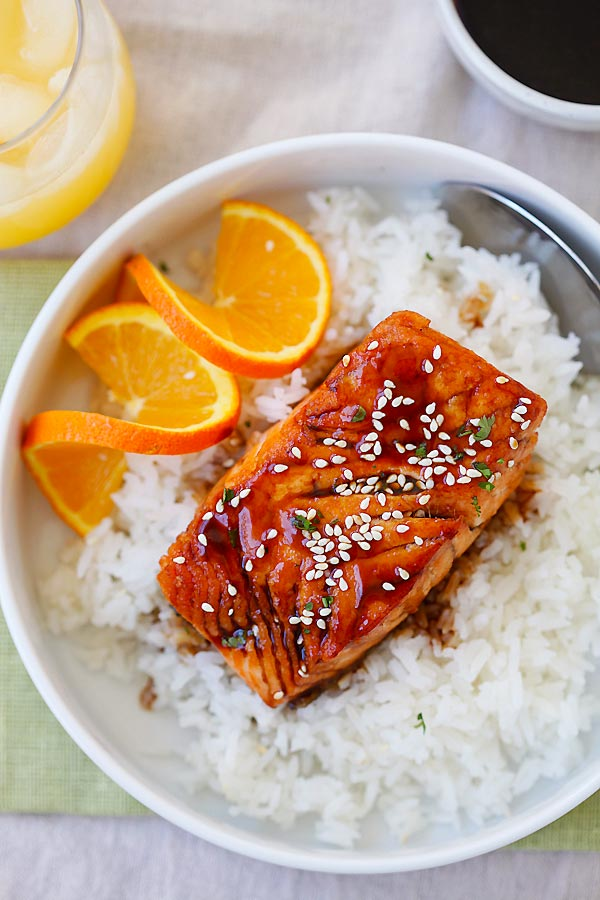 Juicy and delicious salmon with a tangy, sweet and savory orange teriyaki sauce in a bowl with rice.