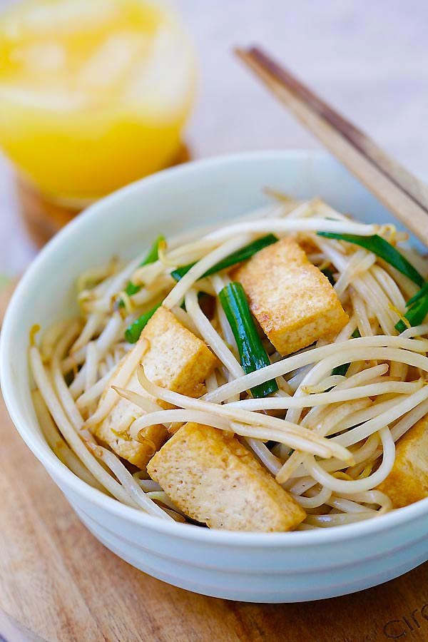 Healthy and quick homemade Asian stir fry Bean Sprouts with Tofu in a bowl ready to serve.