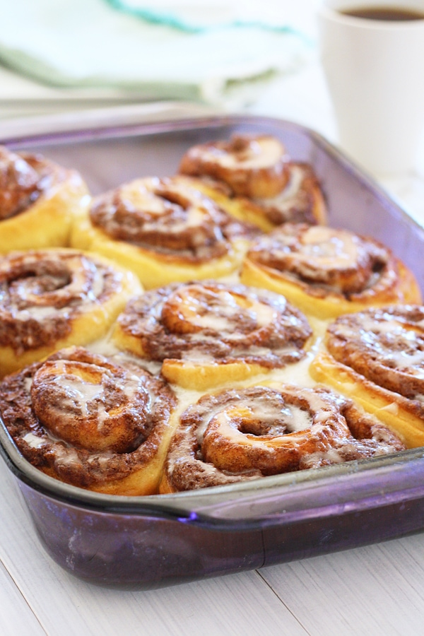 Easy and delicious homemade pizza dough cinnamon rolls in baking tray, ready to be served.