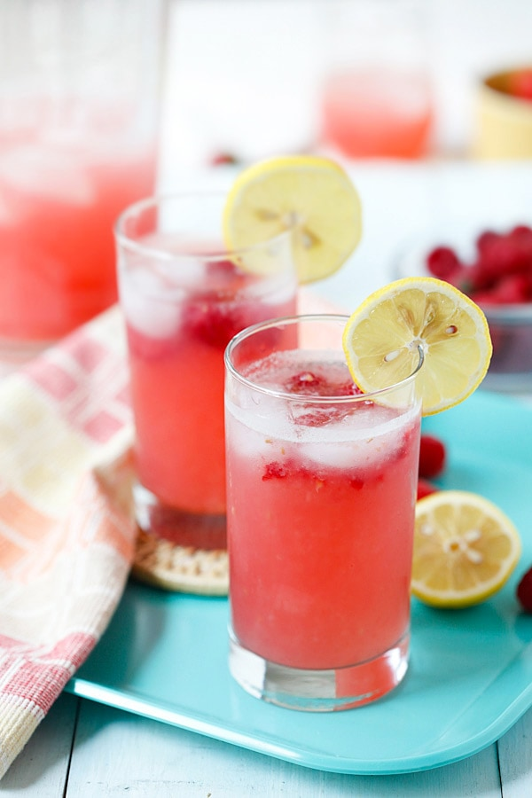Sweet, refreshing and thirst-quenching lemonade with raspberry served in glasses.