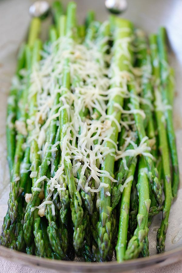 Sauteed Parmesan Asparagus with Parmesan cheese on a skillet.