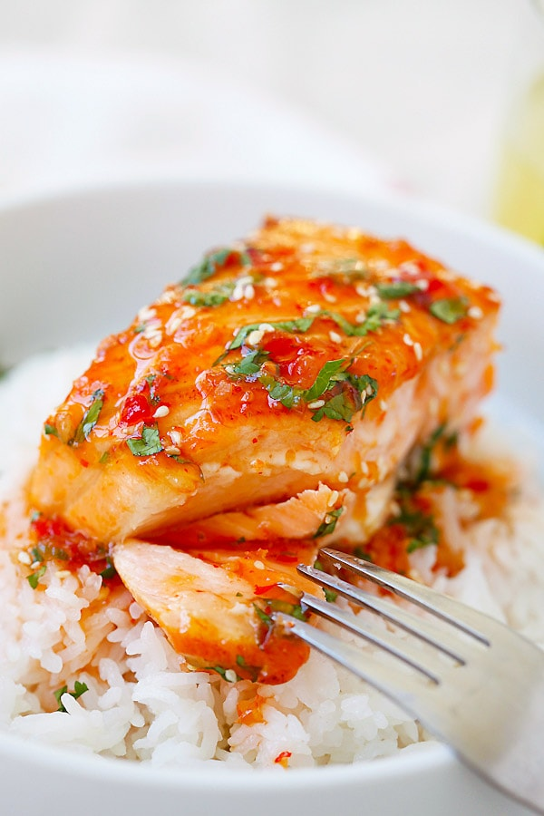 Quick and easy Sweet Chili Salmon cut open with a fork.
