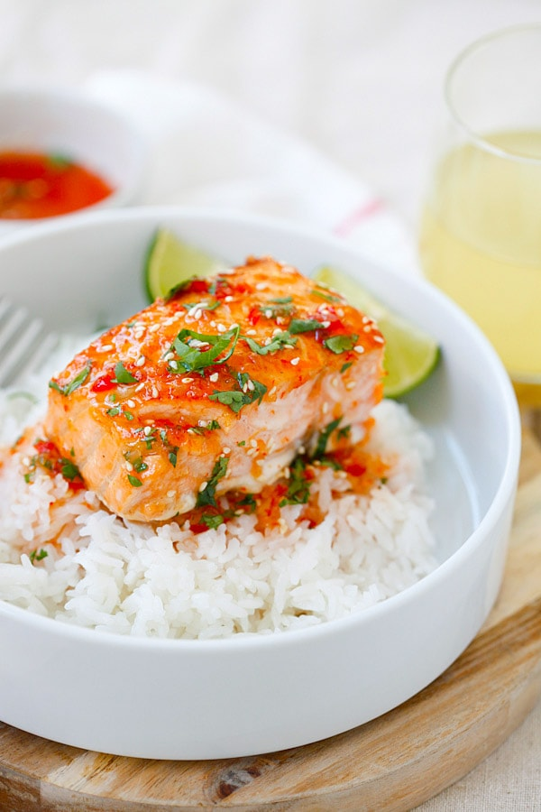 Thai baked Sweet Chili Salmon on top of rice in a bowl.