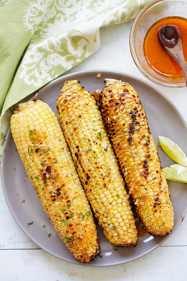 Fresh corn grill without husk.