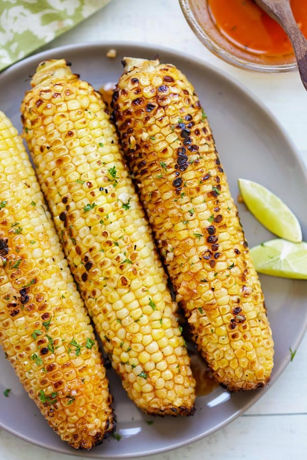 Seasoned grilled corn on the cob with honey glaze and butter.