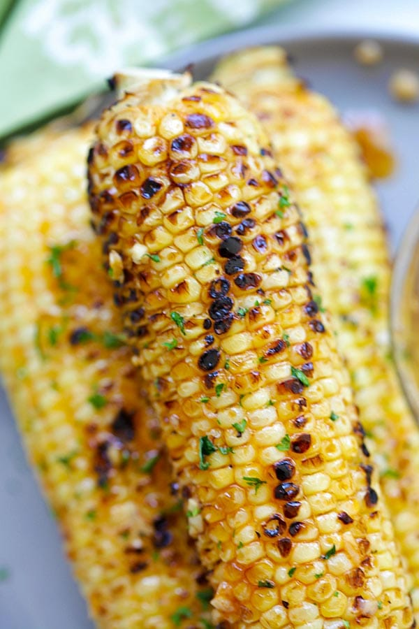Basil Butter Corn - sweet and juicy corn slathered with homemade basil butter and roasted in the oven. Corns have never tasted SO good | rasmalaysia.com