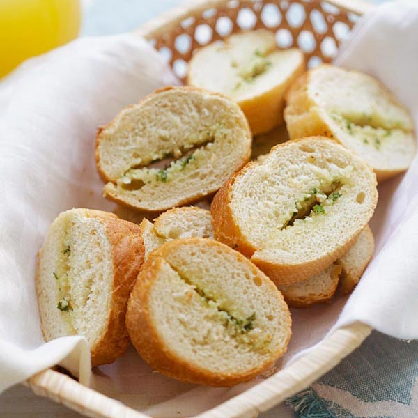 wooden basket of homemade garlic bread