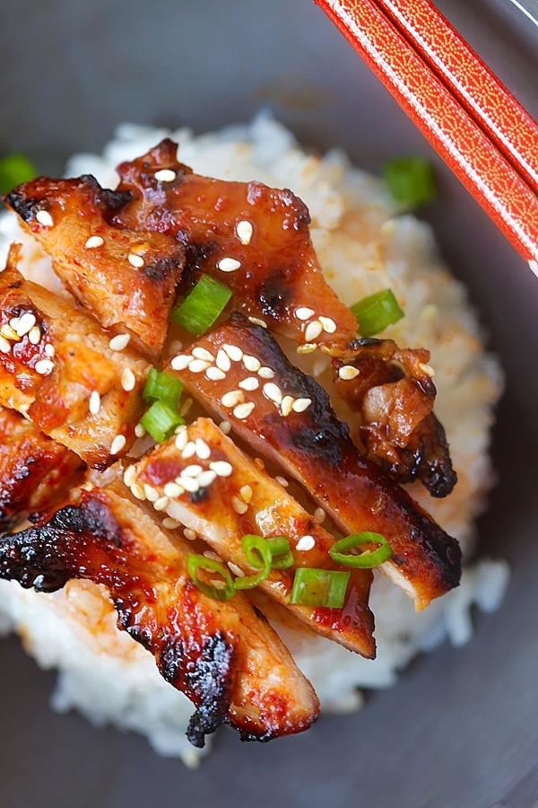 Authentic spicy Korean chicken topped on white rice.