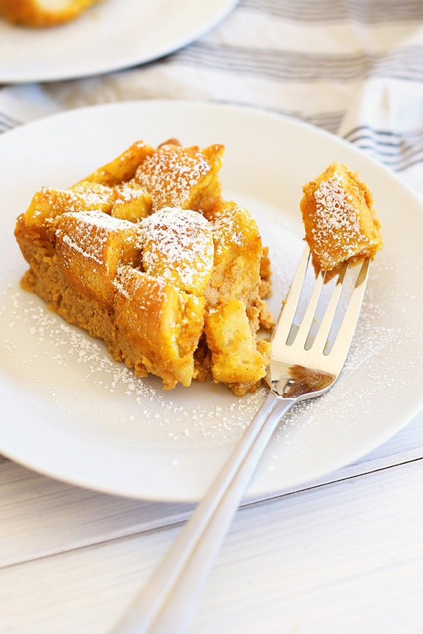 Easy and quick pumpkin bread pudding made with pumpkin spice and egg custard served in a plate with a fork.