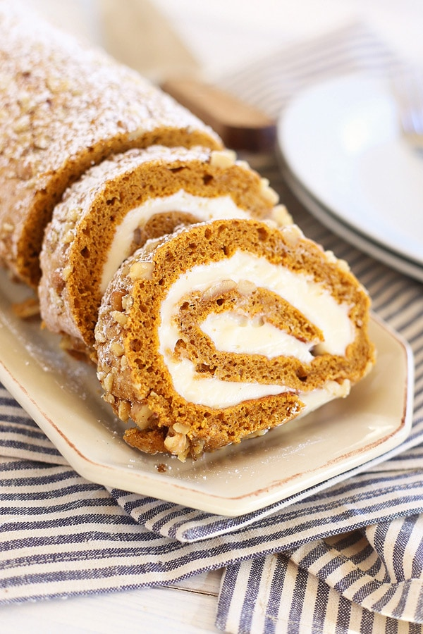 Easy homemade fall pumpkin roll cake, served in a serving dish.