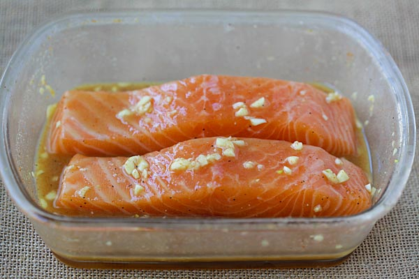 Baked salmon in a baking tray.