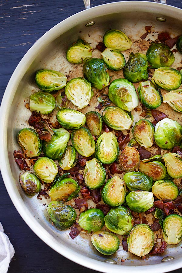 Garlic-Prosciutto Brussels Sprouts - roasted brussels sprouts with smoky prosciutto. Saute on skillet and finish in oven, 20 mins only | rasamalaysia.com