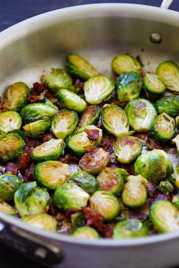 Homemade easy and quick roasted Garlic-Prosciutto Brussels Sprouts in skillet.