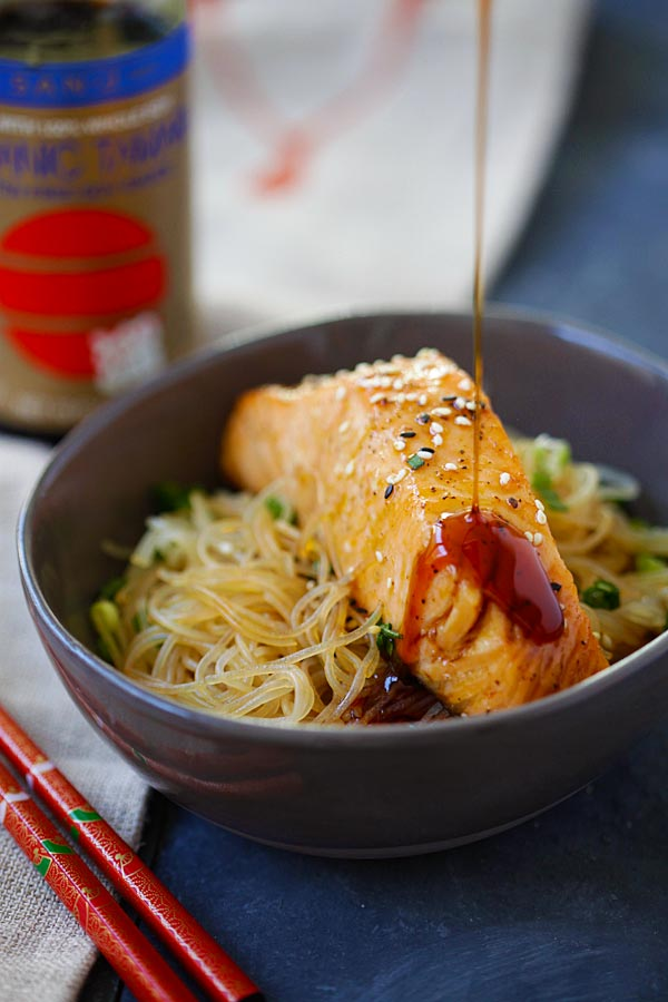 Healthy moist and juicy Salmon Teriyaki Noodles with San-J teriyaki sauce dripping from above.