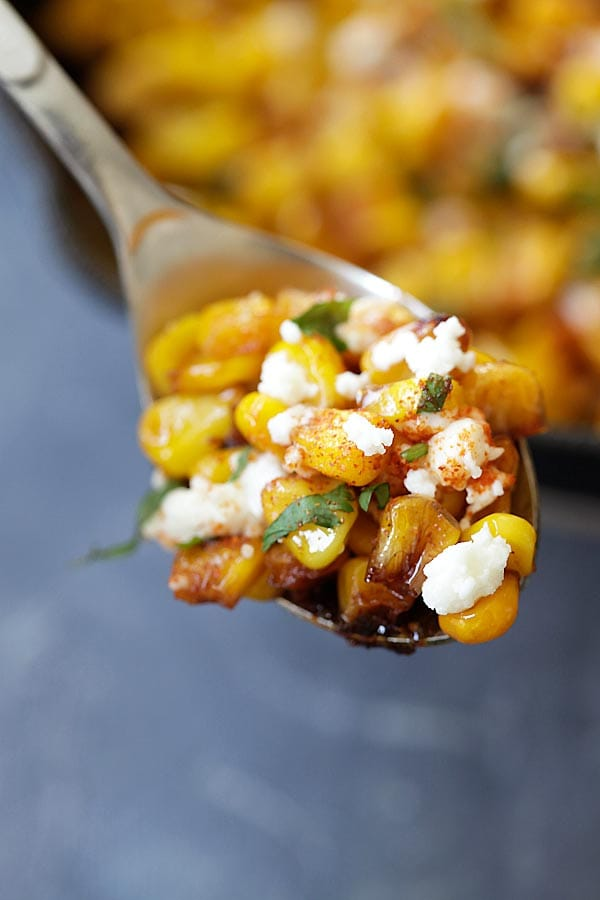 Mexican style skillet Chili Lime Corn on a spoon.