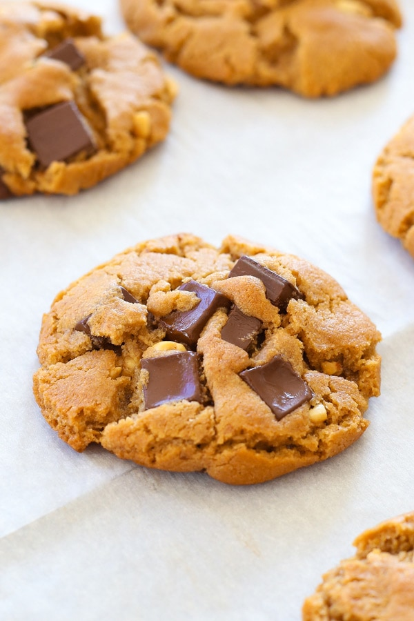Ultimate best peanut butter dark chocolate chip cookies on a baking sheet.