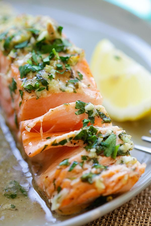 Teared Garlic Herb Roasted Salmon fillet in garlic herb sauces.