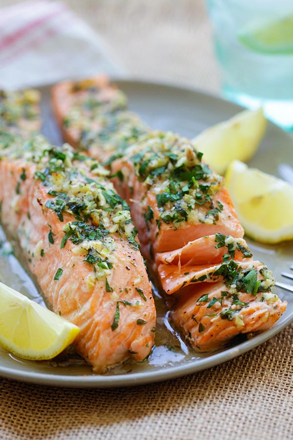 Healthy homemade roasted salmon in a plate, ready to serve.